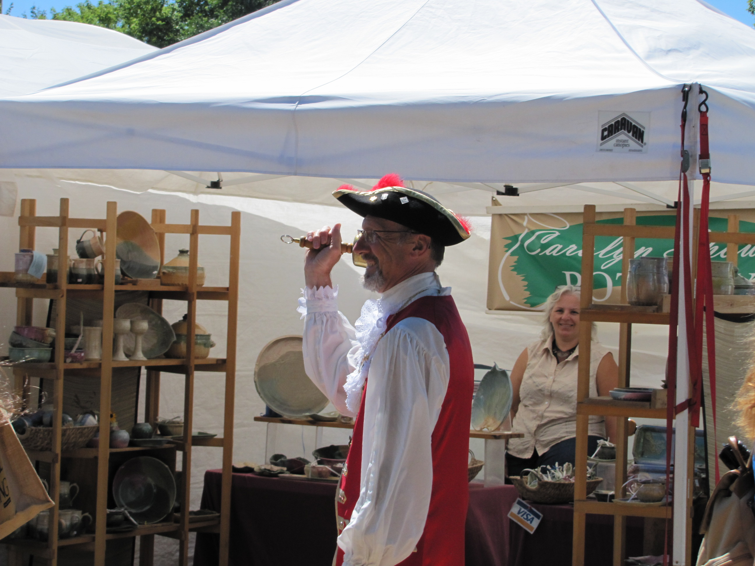 9.9994 FB - The Town Crier welcomes Kempenfest crowds to Barrie -- he was about two days late.